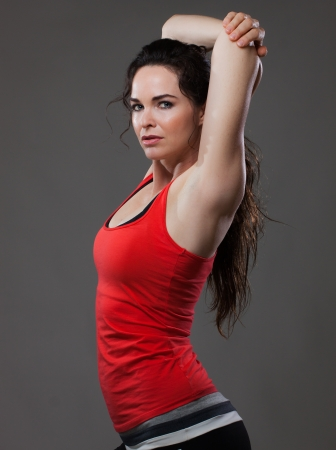 A beautiful sexy woman stretching before or after exercise photo