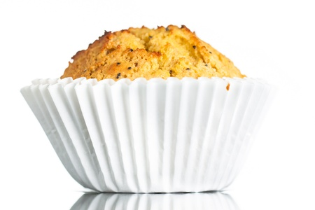 small cake: Close-up of a freshly home baked banana muffin with poppy seeds. Isolated on white.