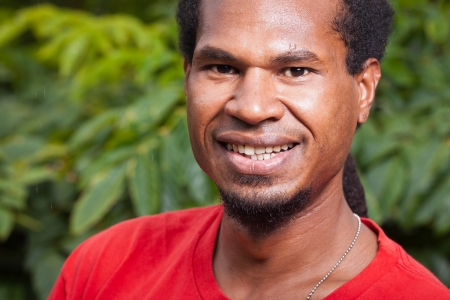 south asian ethnicity: Close-up portrait of a dark skinned smiling young man