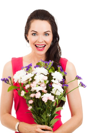 A beautiful young woman holding a bunch of flowers photo