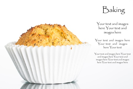 Close-up of a freshly home baked banana muffin with poppy seeds  Isolated on white  photo