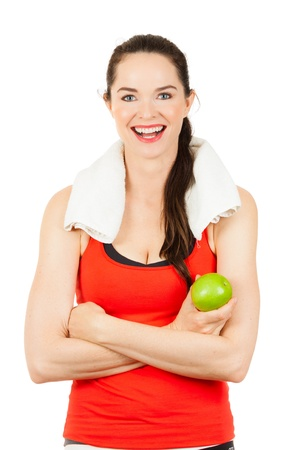 melle: Young happy fit woman holding an apple and smiling after exercise. Isolated on white.