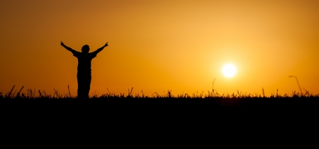 sun worship: A person is celebrating life at a beautiful sunset or sunrise