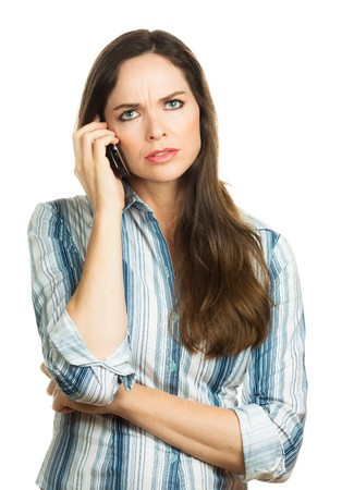 upset woman: An annoyed and very disappointed business woman on the phone  Isolated over white