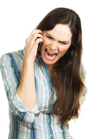 An angry and very frustrated business woman yelling on the phone  Isolated over white