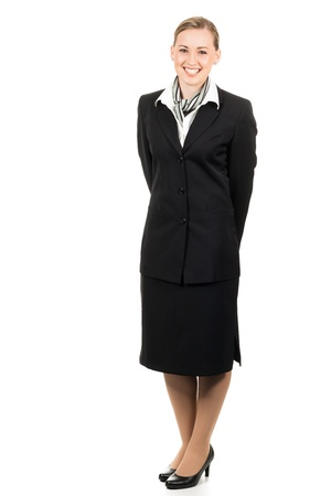 airline hostess: Full length portrait of a friendly young beautiful air hostess. Isolated over white.