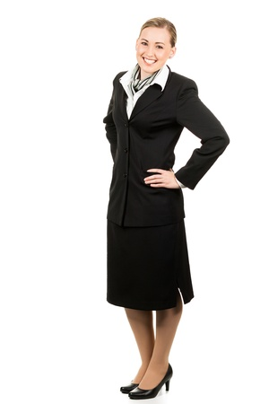 Full length portrait of a happy young beautiful air hostess. Isolated over white.
