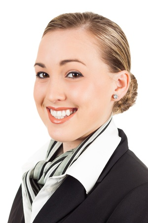 airline hostess: Portrait of a happy young beautiful air hostess. Isolated over white. Stock Photo
