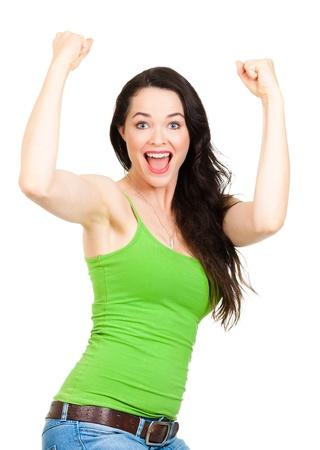 Un ajustement jeune, belle femme heureuse avec les bras en l'air indiquant la réussite Isolé sur fond blanc