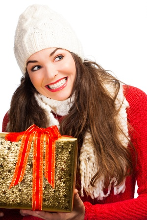 beautifully wrapped: A happy beautiful smiling woman holding a beautifully wrapped Christmas gift. Isolated on white.