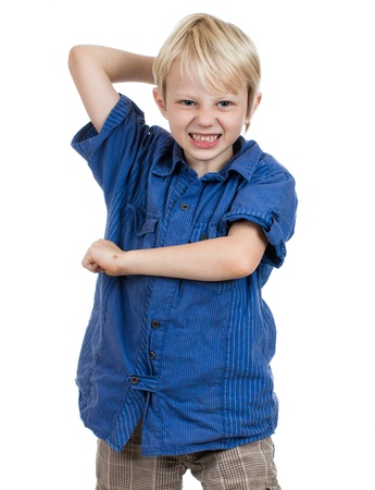 An aggressive young boy about to hit. Isolated on white. Stock Photo - 16037349