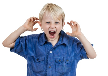 deficit: An angry frustrated young boy screaming. Isolated on white. Stock Photo