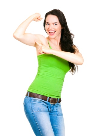 strong arm: A very fit healthy and beautiful woman smiling and pointing at big strong arm muscle
