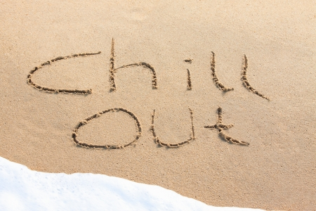 chill out: Chill out - written in the sand with a foamy wave underneath