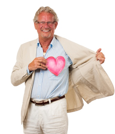 A healthy happy man holding up a love heart in front of his heart  Symolizing love and health  Isolated on white Stock Photo - 17362658