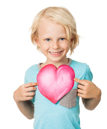 melle: Portrait of a very cute young boy smiling and holding out a love heart  Isolated on white