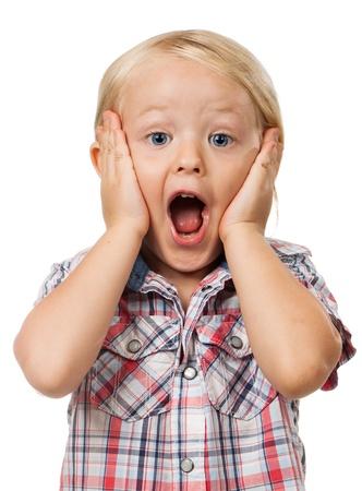 caras de emociones: Un muy lindo chico joven sorprendido mirando a cámara, aislado en blanco Foto de archivo