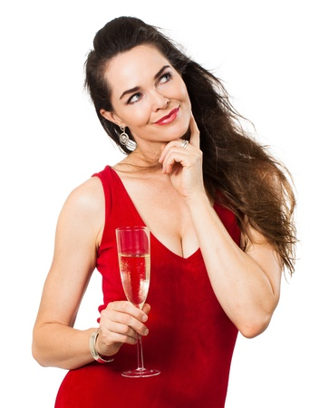 A beautiful woman with a glass of Champagne looking thoughfully at copyspace  photo