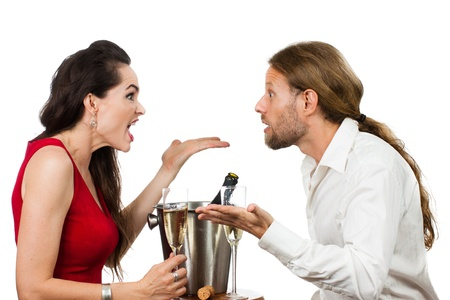 A couple arguing over a glass of Champagne on their Valentine Stock Photo - 17642902
