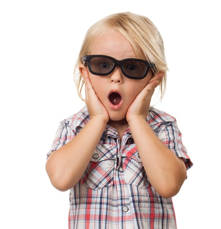 A surprised shocked and scared cute little boy wearing 3D glasses  Isolated on white