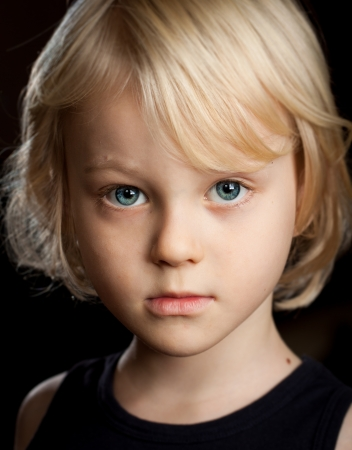 Close-up portrait of a serious young boy looking at camera  Stock Photo