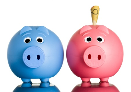 two dollar bill: Two cute piggy banks with Australian dollars in one of them  Isolated on white