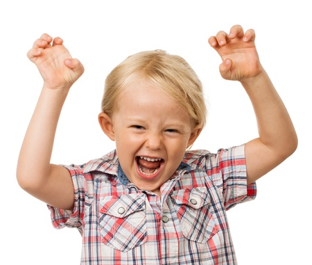 A angry hyperactive young boy yelling  Isolated on white