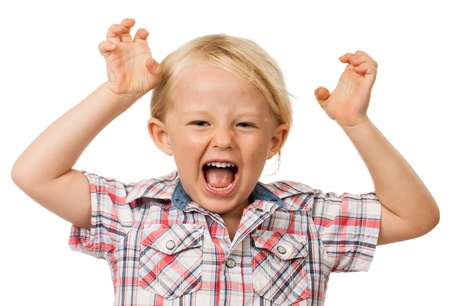 A angry hyperactive young boy screaming  Isolated on white  photo
