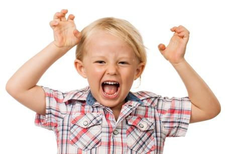 disorders: Un enojado ni�o hiperactivo gritos aislados en blanco Foto de archivo