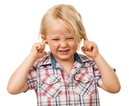 ear protection: A sad boy looking distressed and blocking his ears with his fingers  Isolated on white  Stock Photo