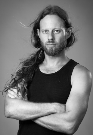 man with long hair: Black and white portrait of a serious man