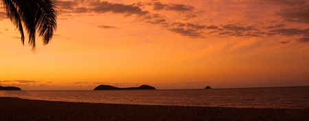 Sunset at a tropical beach, Palm Cove, Queensland, Australia photo