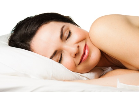 sexy woman on bed: Portrait of a beautiful young woman sleeping peacefully  Isolated over white  Stock Photo