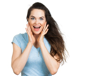 Portrait of a beautiful happy surprised woman   Isolated on white with room for text  photo