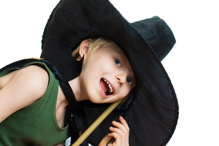 A cute boy dressed up as a witch. Isolated on white. photo