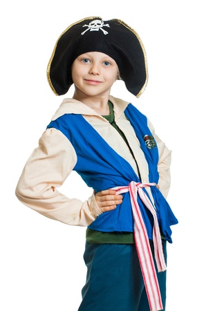 Portrait of a cute young boy dressed as a pirate, Isolated on white. photo