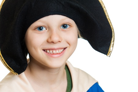 A close-up portrait of a smiling happy boy dressed as pirate. Isolated on white. photo