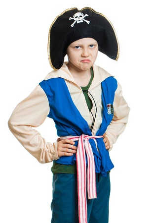 A boy pretending to be a grumpy pirate. Isolated on white. photo