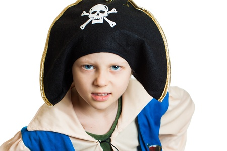 Portrait of a young boy dressed up as a pirate. Isolated on white. photo