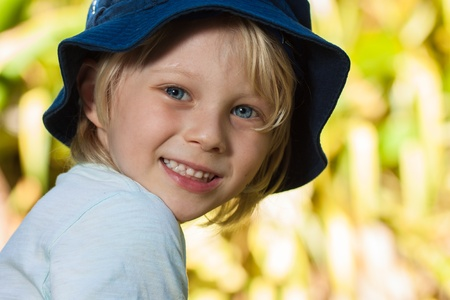 A close-up portrait of a cute young boy outdoors Stock Photo