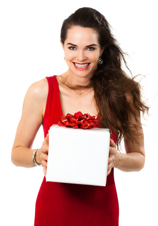 A beautiful happy woman holding a gift  Isolated on white  photo