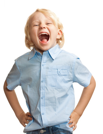 Isolated portrait of a cute young boy screaming photo