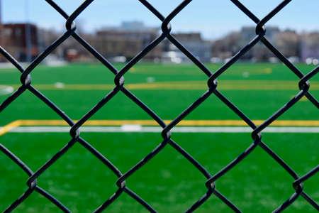 Astrotuf soccer field through chainlink fence