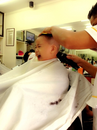 ticklish boy in haircut time