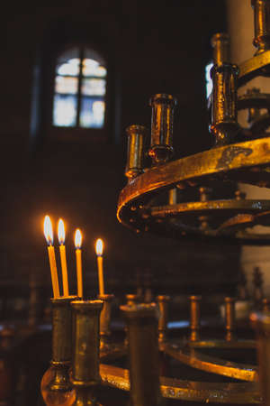 View of a candlestick with candles inside an Orthodox cathedral in Bulgaria