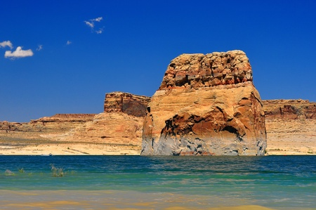 Solitary rock in the middle of lake powell Banco de Imagens