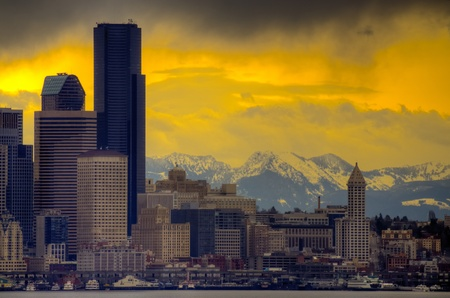 ferry: Downtown Seattle with dramatic sky and Cascade Mountains in the background