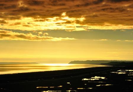 Golden sunset at Turnagain Arm near Anchorage, Alaska. Banco de Imagens