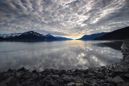 Overcast sky reflecting on water