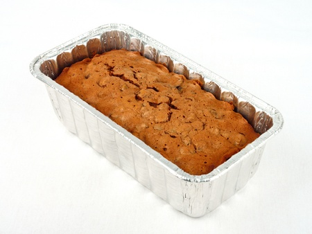 Freshly baked Plum Cake in a cake tray photo